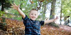 kid in leaves